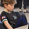 MIKE SPRINGER/Staff photo<br /> Fifth-grader Jack Lawler works on his own composition Friday at Essex Elementary School.<br /> 3/9/2018