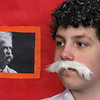 "MIKE SPRINGER/Staff photo<br /> Matthew Sweatt portrays writer Mark Twain in a ""Wax Museum"" event Friday Veterans Elementary School in Gloucester. The entire fifth grade class participated in the program, which was visited by parents and students from other grades.  The fifth-graders dressed as famous historical figures and stood still, like wax statues, until a visitor pushed a button. They would then spring into life and recite a first-person account of the famous person's life.<br /> 3/23/2018"