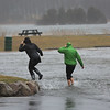 MIKE SPRINGER/Staff photo<br /> Michelle Cain and Naomi Morin, employees of the nearby Shea's Riverside Restaurant and Bar, walk behind Woodman's restaurant to view the flooding at high tide Friday in Essex.<br /> 3/2/2018