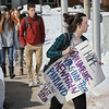 MIKE SPRINGER/Staff photo<br /> A student carries a sign calling attention to a series of school shootings as she and others walk out of Gloucester High School Thursday morning to call for political action to end gun violence in American schools.<br /> 3/15/2018