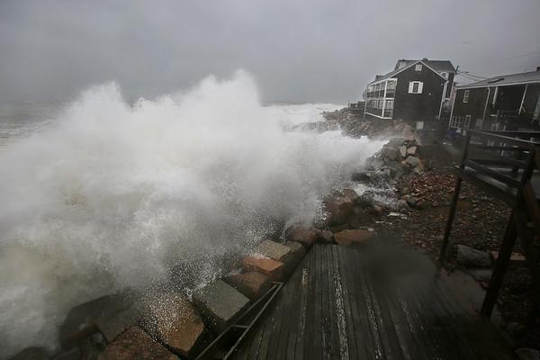 MIKE SPRINGER/Staff photo<br /> A storm wave crashes over a seawall Friday on Bearskin Neck in Rockport.<br /> 3/2/2018