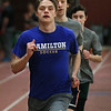 MIKE SPRINGER/Staff photo<br /> Senior Chris MacDonald leads the pack as he and senior Cory Hurd, center, and Natt Carter, a junior, during the first day of track practice Monday at Gloucester High School.<br /> 3/19/2018