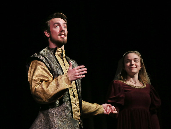 "MIKE SPRINGER/Staff photo<br /> Ben Fuller plays narrator Miguel de Cervantes and Olivia Newman plays Dorotea in the Rockport High School production of ""Don Quixote.""<br /> 2/27/2018"