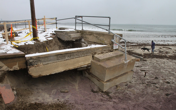 MIKE SPRINGER/Staff photo<br /> The damaged seawall on the Gloucester side of Long Beach as it appeared Friday. The wall was damaged by waves and sand erosion during the recent nor'easters.<br /> 3/9/2018