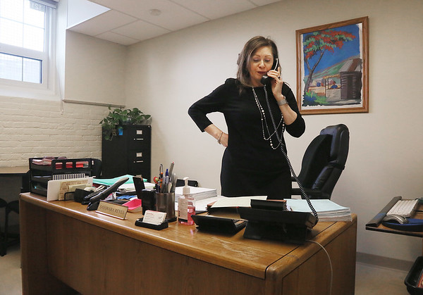 MIKE SPRINGER/Staff photo<br /> Sayonara Reyes, manager of the Parent Information Center, talks on the phone Thusday in her office at Collins Middle School.<br /> 3/1/2018