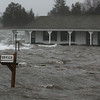 MIKE SPRINGER/Staff photo<br /> Floodwaters engulf Shea's Riverside Inn & Motel at high tide Friday in Essex.<br /> 3/2/2018