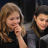 MIKE SPRINGER/Staff photo<br /> Fifth graders Brooke Matook, left, and Lola Fortunato look at Brooke's musical composition on the computer screen during a composer-in-residence program Friday at Essex Elementary School. Classical composer G. Paul Naeger of Ipswich has been working with students in Rich Carpenter's fifth-grade music class in a program sponsored by the Spaulding Education Fund.<br /> 3/9/2018