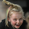 """MIKE SPRINGER/Staff photo<br /> First-grader Kaila Cauthers wears a """"unicorn"""" hairdo Friday during the first-ever """"Crazy Hair Day"""" at East Gloucester Elementary School.<br /> 3/30/2018"""
