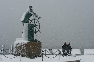 Desi Smith Photo.  Gloucester resident Carole DeSantis takes a storm selfie in front of the Fishermen's Statue with friends Kendra Tolman and Paula Burns,Tuesday morning. They also had some more fun throwing snow at each other,after the photo.   March 13,2018.