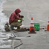 MIKE SPRINGER/Staff photo<br /> Tim Lodge of the Department of Public Works examines a piece of pipe while fixing a water line break Thursday on Whittemore Street in Gloucester.<br /> 3/15/2018 [[MER1803151537484068]]