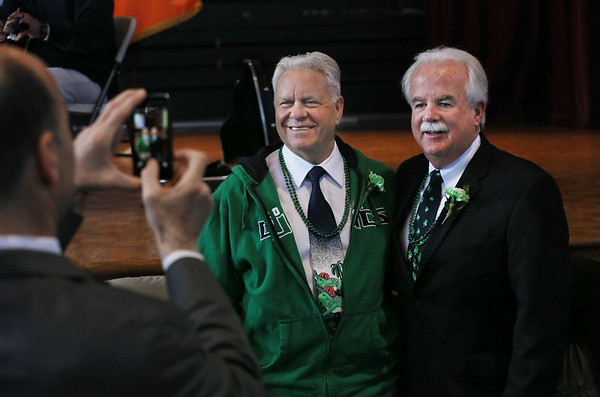 MIKE SPRINGER/Staff photo<br /> Peabody interim school superintendent Herbert Levine, left, and Essex County Sheriff Kevin Coppinger pose for a photograph during the annual St. Patrick's Day breakfast Saturday at Peabody City Hall.<br /> 3/17/2018