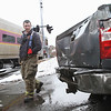 MIKE SPRINGER/Staff photo<br /> Gloucester fire captain Jamie Santos and firefighter Alison DeMuele, left, look at the damage to the back of a Chevrolet Silverado pickup truck that was hit Thursday by an MBTA commuter train at the intersection of Cedar and Willow streets in Gloucester. The woman who as driving the truck was uninjured. The train was delayed for 15 or 20 minutes while police investigated. There was no apparent damage to the train.<br /> 3/22/2018