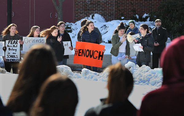 MIKE SPRINGER/staff photo<br /> Students speak out against gun violence during a walkout Thursday at Gloucester High School.<br /> 3/15/2018