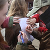 MIKE SPRINGER/Staff photo<br /> Students sign a letter to state Senator Bruce Tarr calling for more legislative action to protect them from gun violence during a walkout Wednesday at Rockport High School and middle school to protest U.S. gun policy on the one-month anniversity of the February 14 mass shooting at Marjory Stoneman Douglas High School in Parkland, Florida. About 200 high school and middle school students participated in the Rockport protest.<br /> 3/14/2018