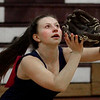 MIKE SPRINGER/Staff photo<br /> Eighth-grader Natalie Aiello prepares to catch the ball during the first day of softball practice Monday at Gloucester High School.<br /> 3/19/2018