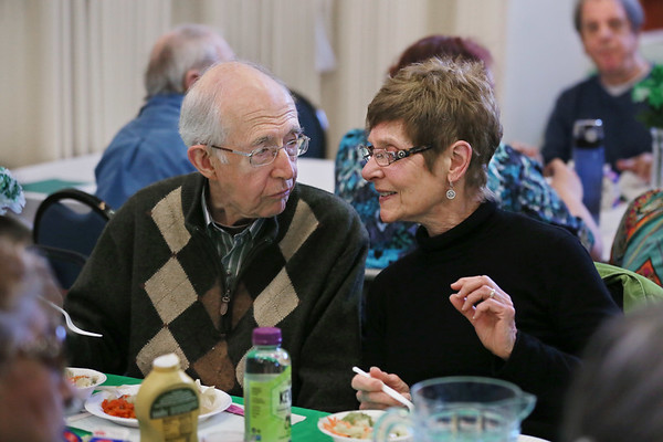 MIKE SPRINGER/Staff photo<br /> Dan and Nana Dunn enjoy the St. Patrick's Day luncheon Thursday at the Rose Baker Senior Center in Gloucester.<br /> 3/15/2018