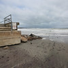 MIKE SPRINGER/Staff photo<br /> The seawall stands out above the beach Monday on the Gloucester side of Long Beach after the weekend's storm washed much of the sand out from around it.<br /> 3/5/2018