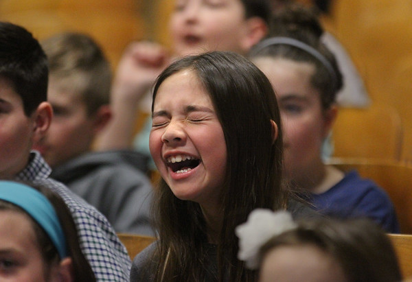 MIKE SPRINGER/Staff photo<br /> Fourth-grader Cassidy Bolcome laughs during a Japanese drumming show Thursday at East Gloucester school.<br /> 3/28/2018