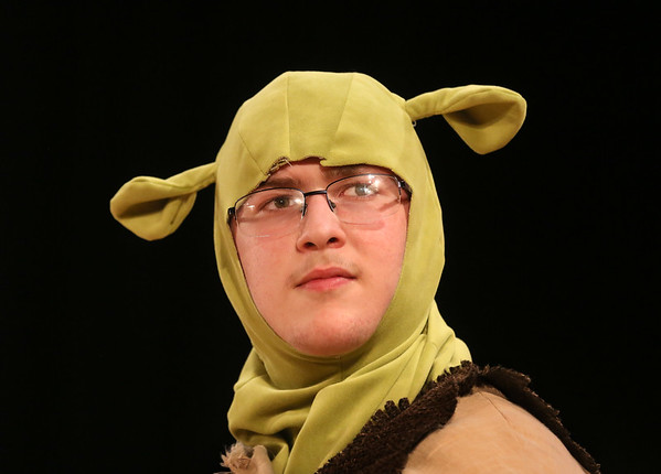 MIKE SPRINGER/Staff photo<br /> Colby Laing performs the lead character Shrek during a rehearsal Monday for the O'Maley Academy production of Shrek Jr. at O'Maley Middle School.<br /> 2/26/2018