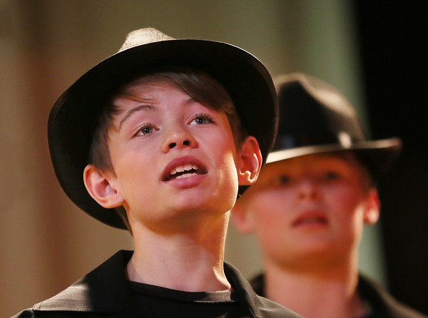 "MIKE SPRINGER/Staff photo<br /> Carson Croft  sings a song during a rehearsal Tuesday for the fifth-grade play, ""The Grunch,"" at Manchester Memorial Elementary School. In the background is Carson's twin brother, Jarett.<br /> 2/27/2018"