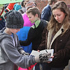 MIKE SPRINGER/Staff photo<br /> Seventh grader Colin Kelley signs a letter to state Rep. Ann-Margaret Ferrante calling for more legislative action on gun violence as sophomore Clara Collins, right, gathers signitures during a student walkout Wednesday at Rockport High School and middle school to protest U.S. gun policy on the one-month anniversity of the February 14 mass shooting at Marjory Stoneman Douglas High School in Parkland, Florida. About 200 high school and middle school students participated in the Rockport protest.<br /> 3/14/2018