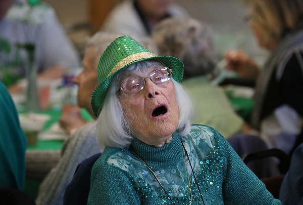"MIKE SPRINGER/Staff photo<br /> Barbara Maddix sings along to ""When Irish Eyes are Smiling"" during a St. Patrick's Day luncheon Thursday at the Rose Baker Senior Center in Gloucester. In addition to the musical sing-along, guests enjoyed a traditional Irish dinner of corned beef and cabbage. St. Patrick's Day will be on Saturday, March 17.<br /> 3/15/2018"
