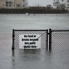 MIKE SPRINGER/Staff photo<br /> The football field at Newell Stadium in Gloucester is under water at midday Friday.<br /> 3/2/2018