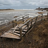 MIKE SPRINGER/Staff photo<br /> A section of the foot bridge at Good Harbor Beach lies in ruin Monday about 100 yards from the rest of the bridge after it was torn away during the weekend's nor'easter.<br /> 3/5/2018