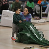 MIKE SPRINGER/Staff photo<br /> Emily Avila and her son Owen Doyle, 3, react happily after Owen made a successful roll using a dinosaur-shaped ramp while candlepin bowling Saturday at the Cape Ann Lanes in Gloucester.<br /> 3/17/2018