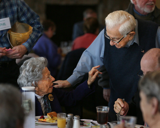 MIKE SPRINGER/Staff photo<br /> Sarah Picone visits with Michael Linquata during the annual Meals on Wheels benefit breakfast Friday at the Gloucester House restaurant.<br /> 3/16/2018