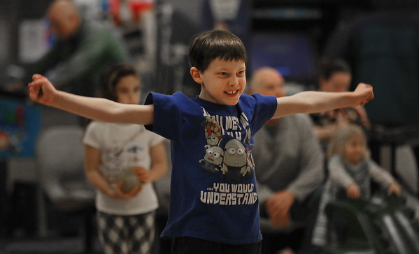 MIKE SPRINGER/Staff photo<br /> Eight-year-old Zach Dirusso of Gloucester celebrates a successful roll while candlepin bowling Saturday at the Cape Ann Lanes in Gloucester.<br /> 3/17/2018