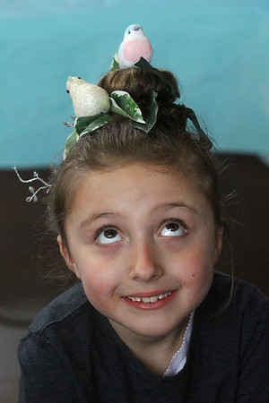 """MIKE SPRINGER/Staff photo<br /> First-grader Iylan Mione wears birds in her hair during """"Crazy Hair Day"""" Friday at East Gloucester Elementary School.<br /> 3/30/2018"""