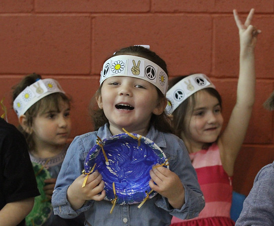 MIKE SPRINGER/Staff photo<br /> Four-year-old Olivia Teel, center, and her classmates Enza Ferrara, left, also 4, and Sofia Figuriedo, 5, celebrate the successful conclusion of a song during a concert for parents Thursday at the Gloucester Public Preschool. The children made their own instruments, including tamborines made from disposable bowls.<br /> 3/29/2018