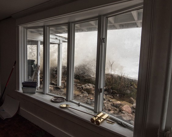 Desi Smith Photo. Not so picture perfect for Magnolia residents Damon Ciaramitaro and wife Claire Locher, as waves crash into their livingroom window at their Shore Rd home Saturday afternoon.    March 3,2018  Desi Smith Photo/Gloucester Daily Times. [[MER1803040913291987]]