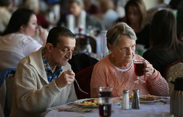 MIKE SPRINGER/Staff photo<br /> Joe and Edie Parisi, both longtime delivery drivers for Meals on Wheels, enjoy a meal of their own Friday morning during the annual Meals on Wheels benefit breakfast at the Gloucester House restaurant.<br /> 3/16/2018