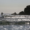 MIKE SPRINGER/Staff photo<br /> A surfer rides a wave Thursday at Good Harbor Beach in Gloucester.<br /> 3/1/2018
