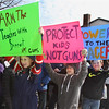MIKE SPRINGER/Staff photo<br /> Seventh graders, from left, Rune Defort, Colin Kelley and Benji Koeplin carry signs calling for gun control during a student walkout Wednesday at Rockport High School and middle school to protest U.S. gun policy on the one-month anniversity of the February 14 mass shooting at Marjory Stoneman Douglas High School in Parkland, Florida. About 200 high school and middle school students participated in the Rockport protest.<br /> 3/14/2018