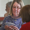 MIKE SPRINGER/Staff photo<br /> Diane Wemyss of Rockport plays canasta with friends at the Rockport Senior Center.<br /> 3/28/2018