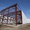MIKE SPRINGER/Staff photo<br /> Construction progresses Wednesday on a medical marijuana facility being built at 38 Great Republic Drive in the Blackburn Industrial Park for the Newton-based Happy Valley Ventures.<br /> 2/28/2018