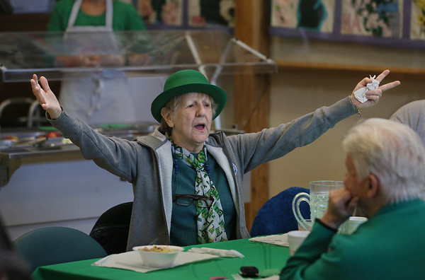 "MIKE SPRINGER/Staff photo<br /> Sadie Cope sings along to ""When Irish Eyes are Smiling"" during a St. Patrick's Day luncheon Thursday at the Rose Baker Senior Center in Gloucester. In addition to the musical sing-along, guests enjoyed a traditional Irish dinner of corned beef and cabbage. St. Patrick's Day will be on Saturday, March 17.<br /> 3/15/2018"