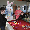 "MIKE SPRINGER/Staff photo<br /> From left, Cape Ann YMCA senior program director Nikki Marin, ""Easter bunny"" Trevor Pelletier, 15, Maya Churchill, 15, and Emma Sperry, 14, fill plastic Easter eggs with candy Wednesday at the YMCA Ben Beyea Youth and Teen Center in preparation for this Saturday's Rockport Community Easter Egg Hunt. The group was joined by Institution for Savings tellers Tobey Odea, Judi Cocotas and Rosalie Ciaramitaro in filling over 300 eggs. The hunt, open to children preschool through first grade, will be held at 2 p.m. Saturday at the Rockport Elementary School, 36 Jerdens Lane. Sponsored by the Rockport division of the Cape Ann Chamber of Commerce with support from the Cape Ann YMCA, the event will include candy and prizes. Children should bring their own baskets.<br /> 3/28/2018"