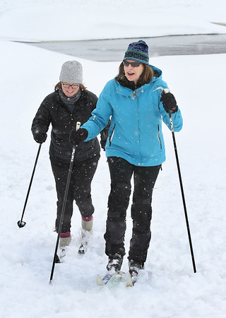 MIKE SPRINGER/Staff photo<br /> Deb deSherbinin, right, and Joan McDonald, both of Manchester, cross-country ski Thursday at the Essex County Club in Manchester.<br /> 3/8/2018