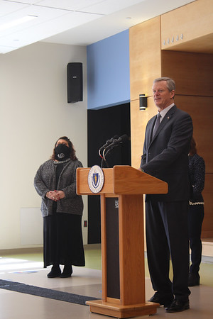TAYLOR ANN BRADFORD/Staff photo/Gov. Charlie Baker announces that the state's teachers will be eligible to sign up for shots on March 11 during a visit to Wst Parish Elementary School. Mayor Sefatia Romeo Thekn is at left.