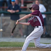Desi Smith/Staff photo.  Rockport's Hadden Roller connects with the ball against Hamilton-Wenham during the Memorial Day Tournament held Friday afternoon at Evans Field in Rockport.   May 27,2016