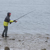 "Desi Smith/Staff photo.    (Cast Away)    Andrew Posfai of Gloucester casts off in hopes to reel in a striper,which he called ""hold overs"" from last year that haven't migrated down, Thursday afternoon behind the Gloucester High School."