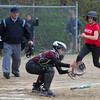 Desi Smith/Staff photo.   Rockport's Katie Favaloro receives a throw at home in time to tag out Masco's Nora Kelly Friday afternoon at Rockport High School.    May 13,2016