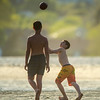 Desi Smith/Staff photo.   A young boy looks to pull in a pass while hanging with friends at Good Harbor Beach last Sunday afternoon May 22,2016.
