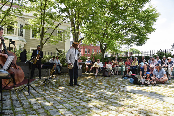 Desi Smith/Staff photo.   Singer Henri Smith and his band plays to a large crowd in the Courtyard at Cape Ann Museum on Pleasant Street as part of the Harbortown Arts Festival Saturday afternoon.  May 28,2016
