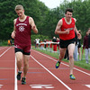 DAVID LE/Staff photo. Gloucester's Nathan Evans  barely holds off Marblehead's Adam Linsky, right, at the finish line of the boys mile race on Tuesday afternoon. 5/24/16.