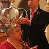 Gloucester: At the Annual Crowning Feast of the Holy Spirit held at Our Lady of Good Voyage Parish on Sun., May 15, 2016. Bart and Mary Piscitello were honored this year with the Crown and they and their family were crowned first at the end of the Mass.  Mark Davis carefully holds the Crown while Mary Piscitello wears it during the ceremony. Photo by Allegra Boverman